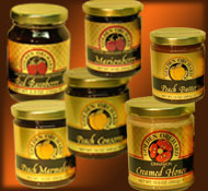 select 6 jars of Golden Orchard preserves, honeys and other products